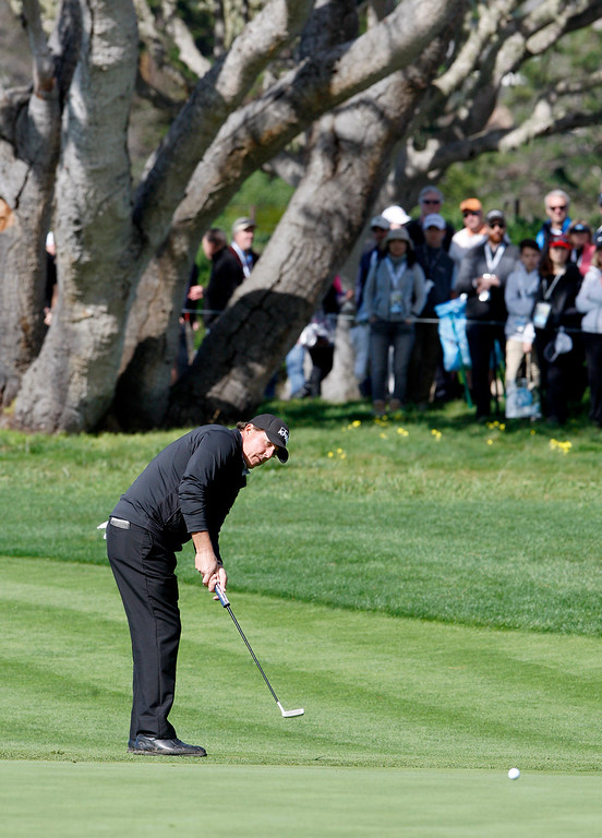 . Phil Mickelson attempts a birdie putt on the 5th hole at the Pebble Beach Golf Links during the third round of the AT&T Pebble Beach Pro Am on Saturday, Feb. 11, 2017.   (Vern Fisher - Monterey Herald)