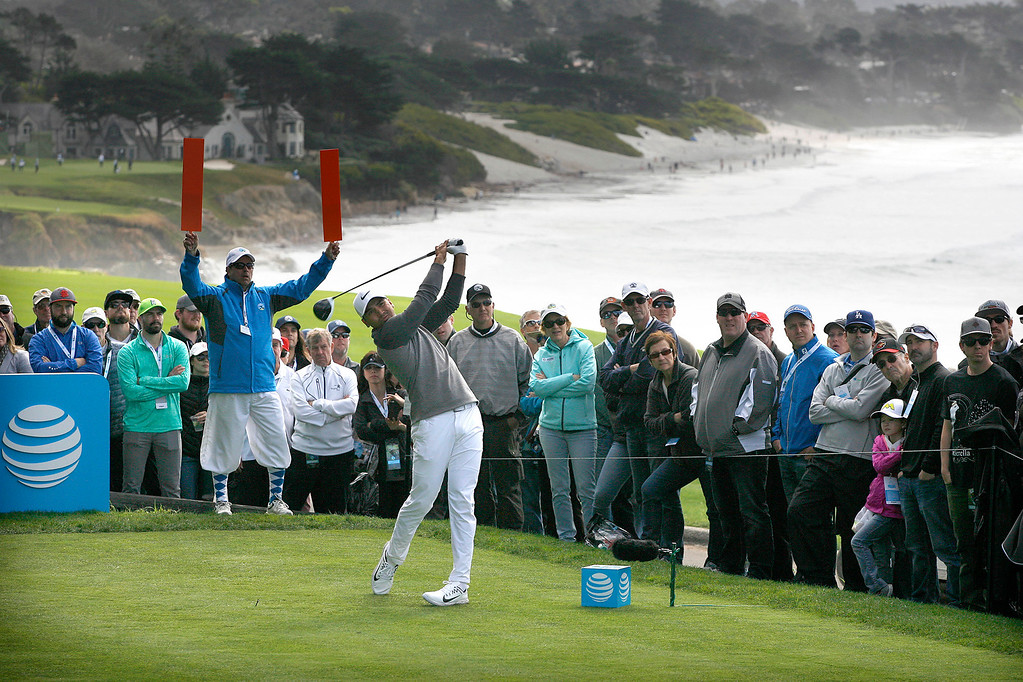 . Jason Day tees off on the 13th hole at the Pebble Beach Golf Links during the third round of the AT&T Pebble Beach Pro Am on Saturday, Feb. 11, 2017.   (Vern Fisher - Monterey Herald)