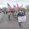 Southwick American Legionaires and Boy Scouts from Post 338 are led by Post Commander Russ Pike during Monday's flag line event at Mercy Medical Center in Springfield.