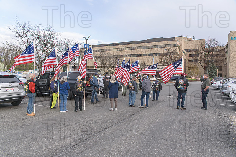 Members of Southwick American Legion Post 338 gather at Mercy Medical Center to hold a flag line honoring healthcare workers.