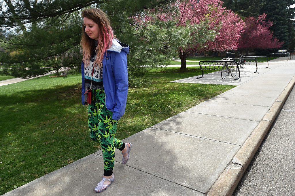 . Elisabeth Opdyke walks home from Norlin Quad wearing pants covered in marijuana leafs at CU Boulder on Wednesday.  For more photos go to www.dailycamera.com Autumn Parry Staff Photographer April 20, 2016