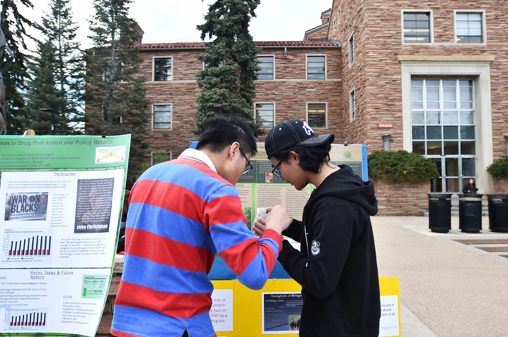 . Students hang up posters informing people about the drug war during a drug war solidarity rally at CU Boulder on Wednesday.  For more photos go to www.dailycamera.com Autumn Parry Staff Photographer April 20, 2016