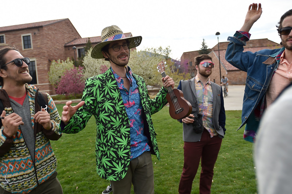 . Drew Wyman talks with friends while they visited Farrand Field to see what was going on for 4/20 at CU Boulder on Wednesday.  For more photos go to www.dailycamera.com Autumn Parry Staff Photographer April 20, 2016