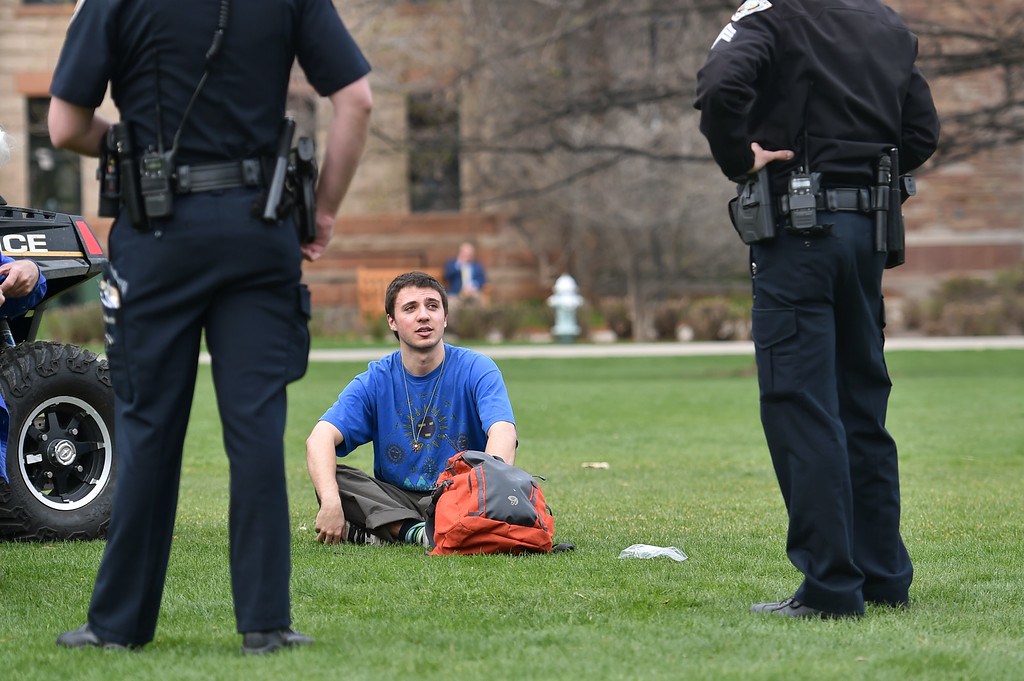. Police contact one of two men about smoking marijuana on Norlin Quad but ultimately did not issue any citations at CU Boulder on Wednesday. For more photos go to www.dailycamera.com Autumn Parry/Staff Photographer April 20, 2016