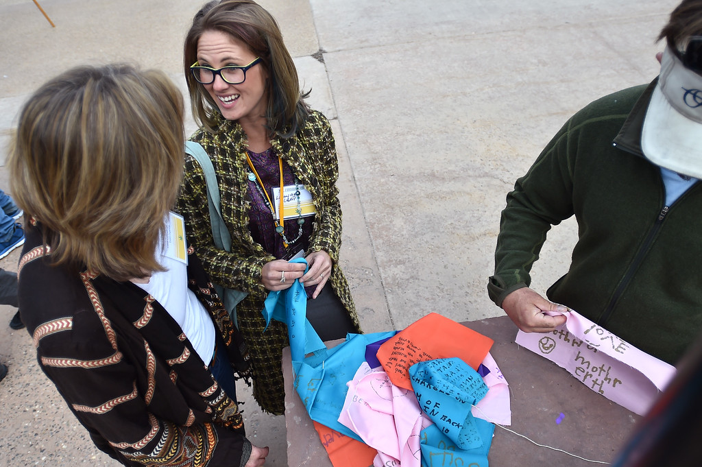 . Carol Conzelman (left) talks with Lindsay Akin as they prepare prayer flags to honor people who have been harmed by the drug war during a drug war solidarity rally at CU Boulder on Wednesday.  For more photos go to www.dailycamera.com Autumn Parry Staff Photographer April 20, 2016