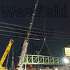 The first span of the rail trail bridge is put in place Monday night.