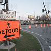 Road closed and detour signs set up.
