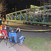 Spectators havee a ringside seat for the installation of the new bike trail bridge.