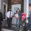 Hilltown Chic owner Cassie Cyr receives a state proclamation from Senator John Velis, with Mayor Don Humason and Chamber President Dino Gravanis also in attendance.