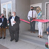 Be Bella Boutique owner Bethany Liquori cuts the grand opening ribbon with State Rep Kelly Pease, Mayor Don Humason, Chamber of Commerce President Dino Gravanis, and State Senator John Velis in attendance.