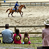 Local folks watching one of the horse shows, in the ring is Justin Rollins 17, with the Pepperell Trail Blazers Riding Club. SUN/ David H. Brow