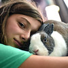 Valerie Wilhelm 14 of Westford cuddles with her rabbit Venti, near the end of the 4-H fair on Sunday. SUN/ David H. Brow