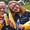 It's Corntastic, two winners in the corn husking contest, grinning ear to ear L-R, Elsa Swanson 10 of Westford and AnaRose Martel 11 of Groton and with the Stoney Brook Saddle Club of Westford. SUN/ David H. Brow