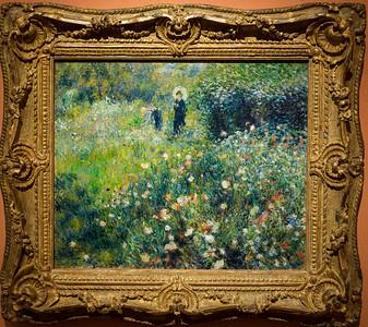 Mujer con Sombrilla en un Jardín (Renoir)
