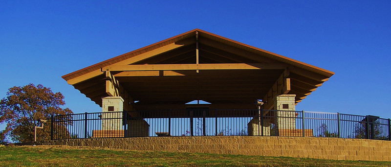 """<a href=""""http://www.martindesignpc.com/"""">Photo Courtesy of Gardner Architecture, a Martin Design Company. Tom Gardner, architect of record.</a>  In 2006, the Hardin County Conservation Board was awarded a Transportation Enhancement project award to build a scenic overlook. The Sac & Fox Recreation area covers 106.2 acres filled with hiking, hunting, wetlands, and wildlife. Within this area is the Sac & Fox Scenic Overlook which provides excellent views of the Iowa River, migrating birds, and is the perfect spot for a picnic.   An award of $300,000 was met with a match of $133,900 to fund a roadside overlook. The project was designed by Martin Design and the work was completed by Wicks Construction. The project included the construction of an open air structure, binocular viewers, restrooms, interpretive panels, parking, sidewalks, and a picnic area.  The Sac and Fox Overlook area is found 1 mile North of Steamboat Rock and is accessible from county road S56."""