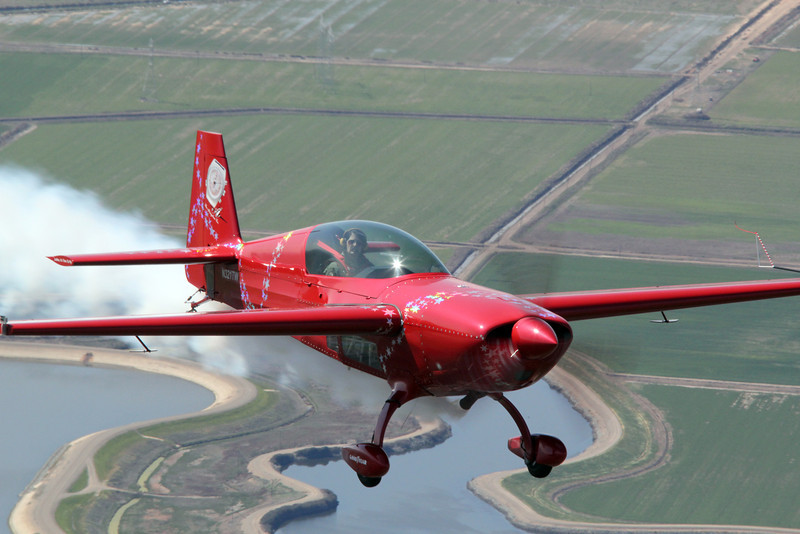 Jacquie Warda in her new Extra 300 with new paint.