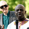 Speaking at the 400th Anniversary of the first enslaved Africans to land in North America, is Gordon Halm of Lowell, in back of him is the Reverend Richard Lewis at St Anne's Church in Lowell. SUN/ David H. Brow