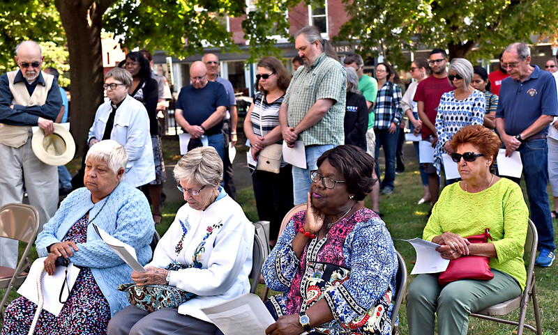 Attendees gather outside of St Anne's Church in downtown Lowell for a Bell ringing to Commemorate 400 year Anniversary of the landing of the first enslaved Africans in English speaking occupied North America. SUN/ David H. Brow