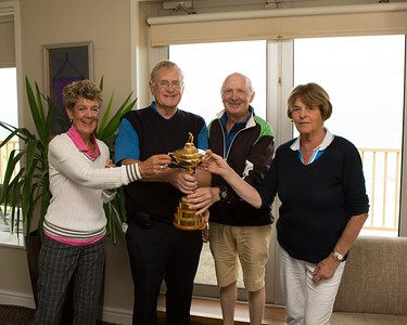 Maureen Feeley, Alistair Smith, Don Deeley, and Eithne Smith get their hands on the Ryder Cup at the 40th Anniversary of Founders Day in Blainroe Golf Club.