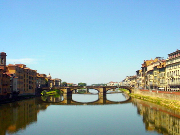 This picture was taken in Florence Italy.  Picture was taken from the Ponte Vecchio looking at the other bridges that crossed the river.  It was this very first cycling trip we took, the one that got us hooked on cycling as a means to see the world.