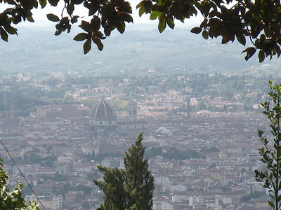 "This picture was taken just before entering Florence.  I learned how to ride a bike only two years ago, and I was so proud to have climbed this ""steep"" mountain without incident, like falling and breaking my face; and behold, I'm looking at Florence down there.   Wow! The Duomo looking through the trees.  I didn't know you could see places like this on a bike."
