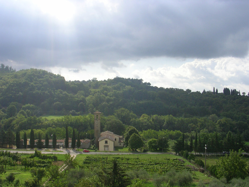 The morning we headed into Florence was slightly overcast. As we ascended a mild incline I looked across a narrow ravine to see a small church lit by a beam of sun that had broken through the clouds. This represents Tuscany to me; the mild climate, the religious heritage, and the fertile green hills.
