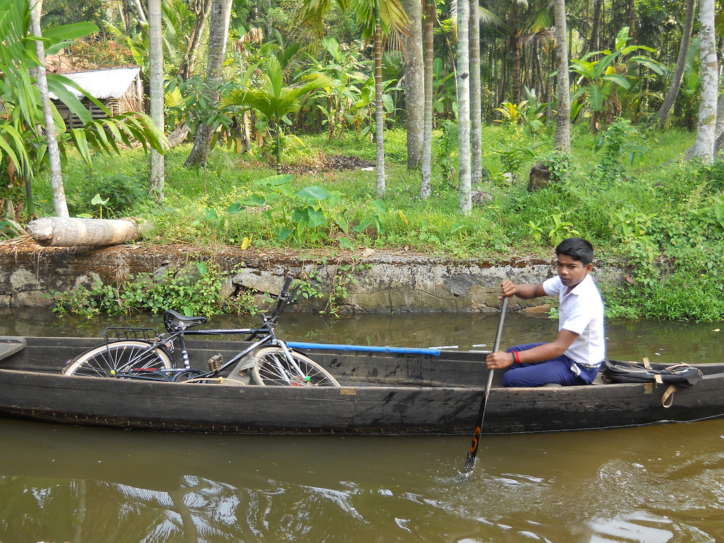I took this photo on a bike trip last year in Kerala, India. I was on my bike when I saw this boy rowing his bike to school.