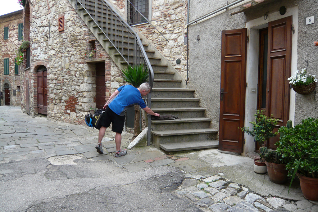 """After a fantastic cruise on a curvy and wooded road into to Suvereto, we took some time to walk around and enjoy the town. I submit this photo under this category by way of a good """"moment"""" pic (plus I am counting architecture and the great streetscape as part of the culture too)."""