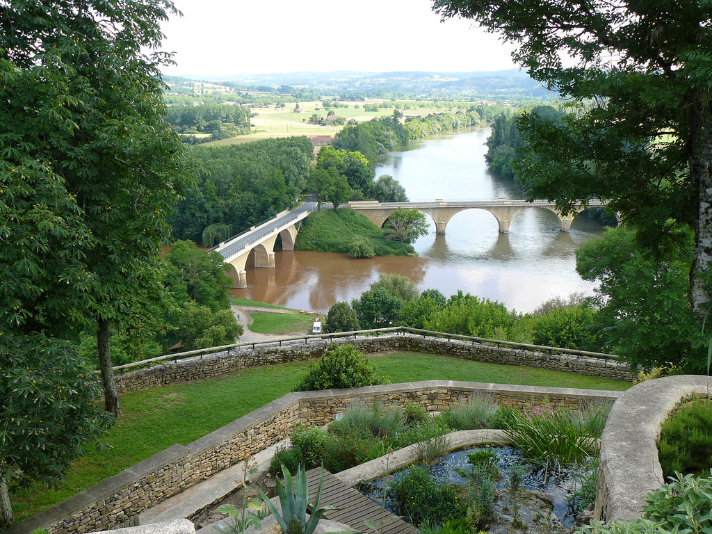 The junction of the Vezere and Dordogne Rivers, France. Not all of us saw from this vantage point as first you biked up to the village above the main highway and then you had to pay extra to walk up through the gardens, but the view was worth it. That's what bike travel is all about, the opportunity of a different vantage point!