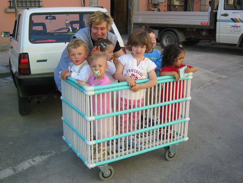 Transporting day-care children – a wonderful illustration of how we might get by without minivans.