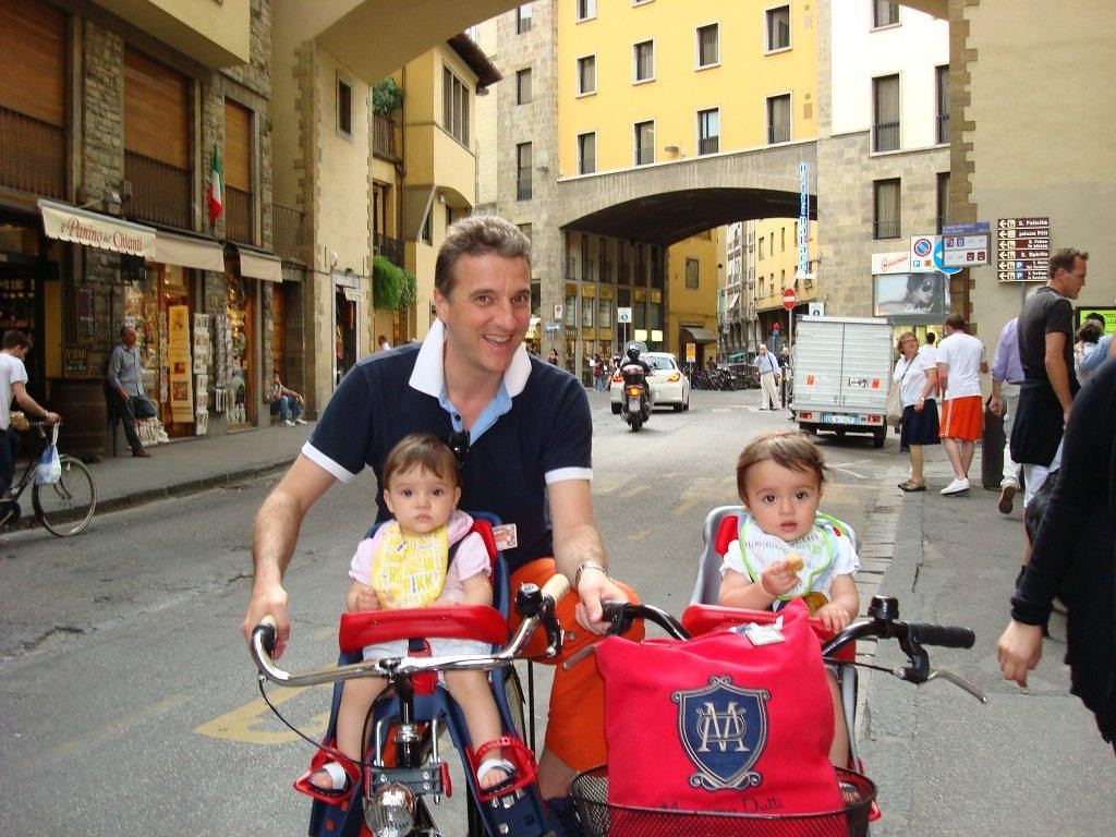 Walking around the streets of Florence,   I saw these beautiful little children and some how asked if I could take a picture.  I love that everyone rides their bikes in town- so much better then sitting in a car..