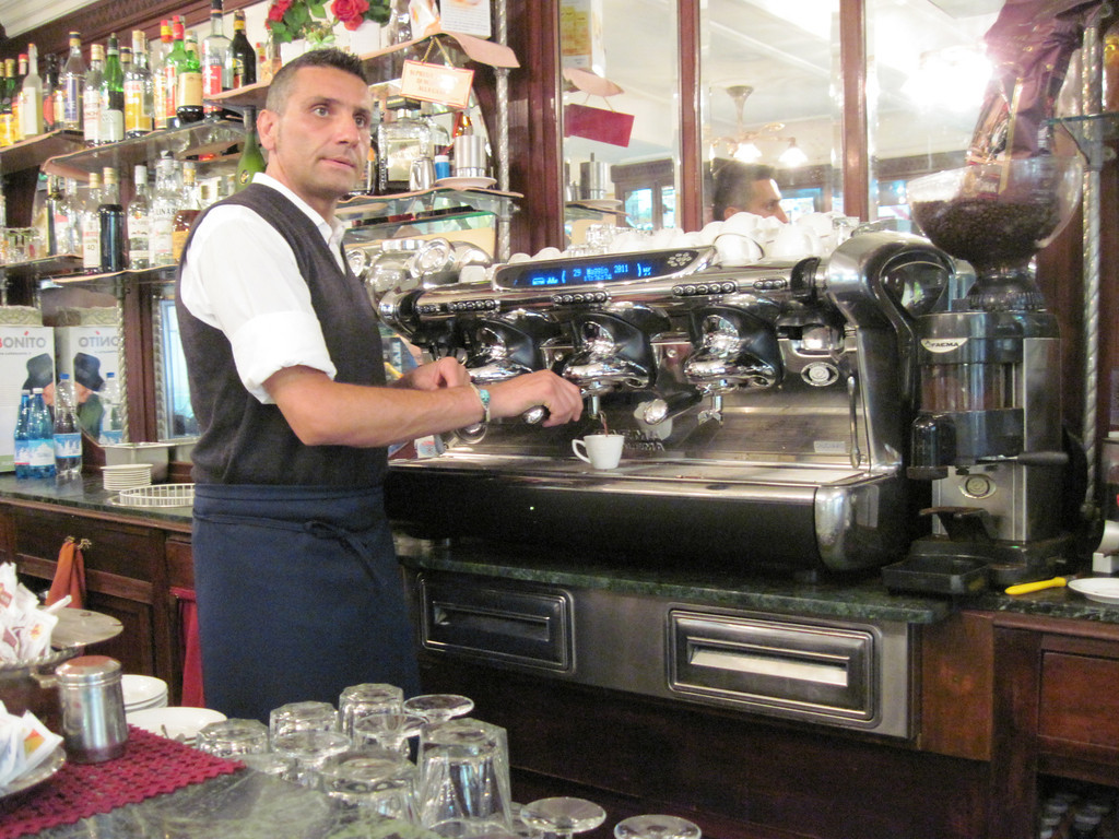 While several more cultured cyclists attended a Puccini concert at the Basilica of San Giovanni in Lucca, I sought to find him at the Antico Caffè Di Simo.  Instead I encountered this humorless yet efficient barista, tending bar at this atmospheric café once patronized by Puccini and his associates.  Puccini was born two years before Italy's 150th birthday, the reason for our 2011 ExpeditionPlus! bike tour across Italy.