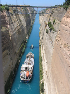 Corinth Canal, Greece Chugging along...how I felt somedays. Good thing we can draft much like these boats. Looking over the railing as our trip comes to an end. We had great timing to watch the boats pass through.