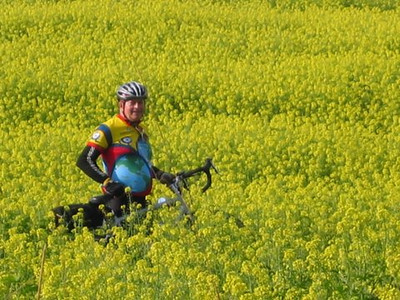 "Dave Forester proves he can ""cut the mustard"" when it comes to cycling. Mustard field, Czech Republic, September, 2006."