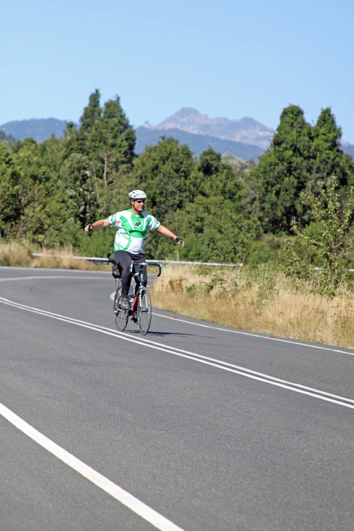 Cyclist Michael Jackson lets it all hang out as he enjoys the pleasures of cycling all alone on an isolated stretch of road near Puyehue, Chile.