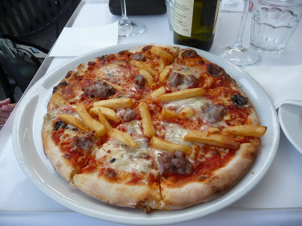 This is a happy accident, that we thought was going to be an appetizer plate of Gorgonzola cheese, sausage and french fries. Out came this pizza. It was delicious!