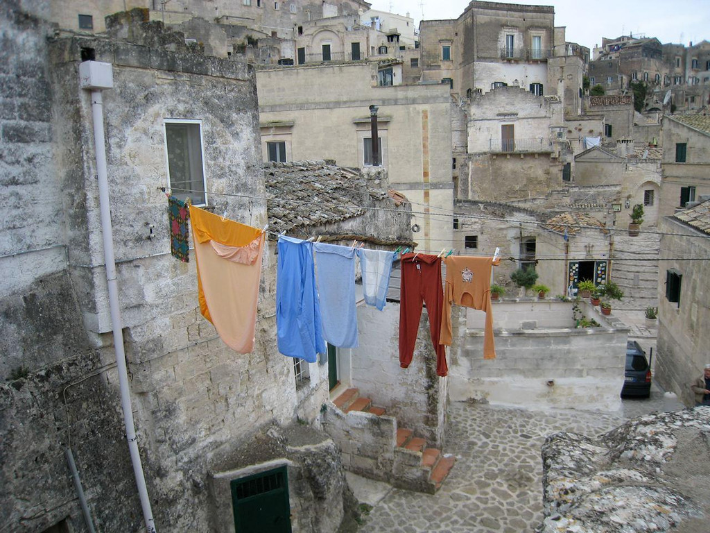 This photo was taken in Matera, Italy. I love the contrast of the colorful laundry against the monotones of the sassi.