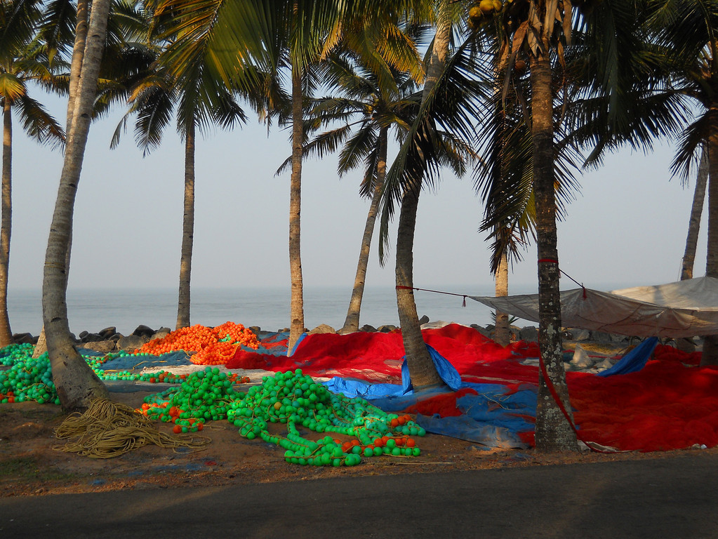 I took this photo on a bike trip in Kerala, India last year.  I was biking on this road by the ocean when I saw these beautifully colored fishing nets.
