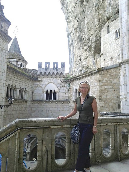 Exploring the chapels at Rocamadour. Notice how the churches are build right up against the rock: the inside wall is the actual rock.