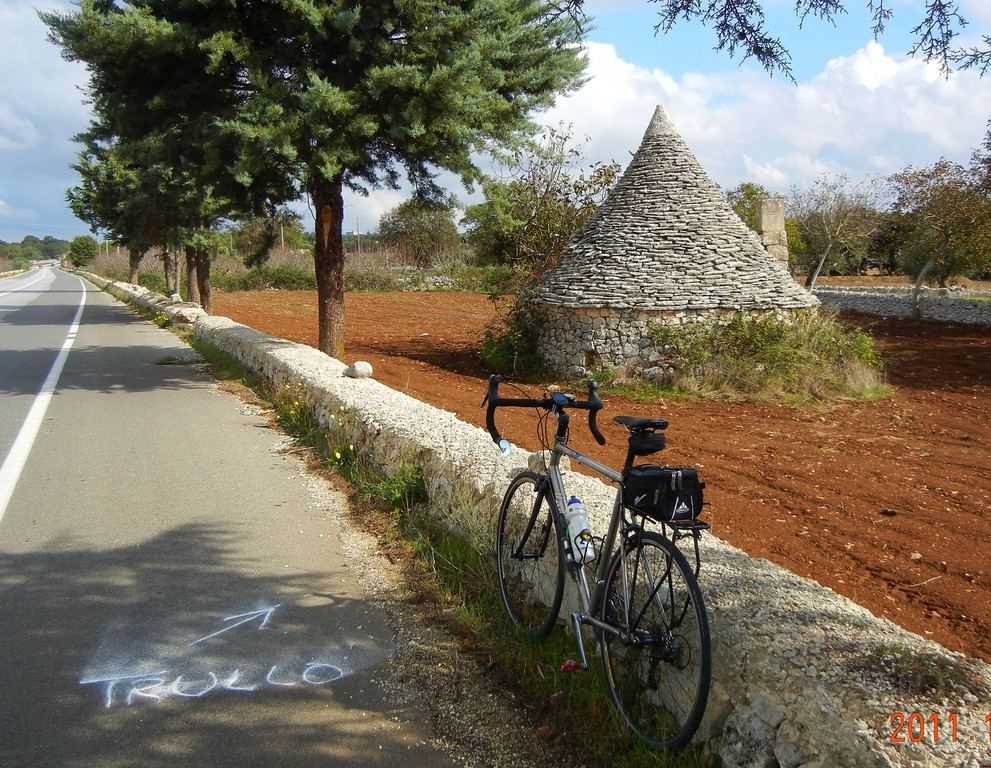 Puglia, Italy, on the road to Allerobella. The whole area was dotted with these strange stone huts. Trullos. This was the first we had seen, but later we spent the night in one. A unique experience.