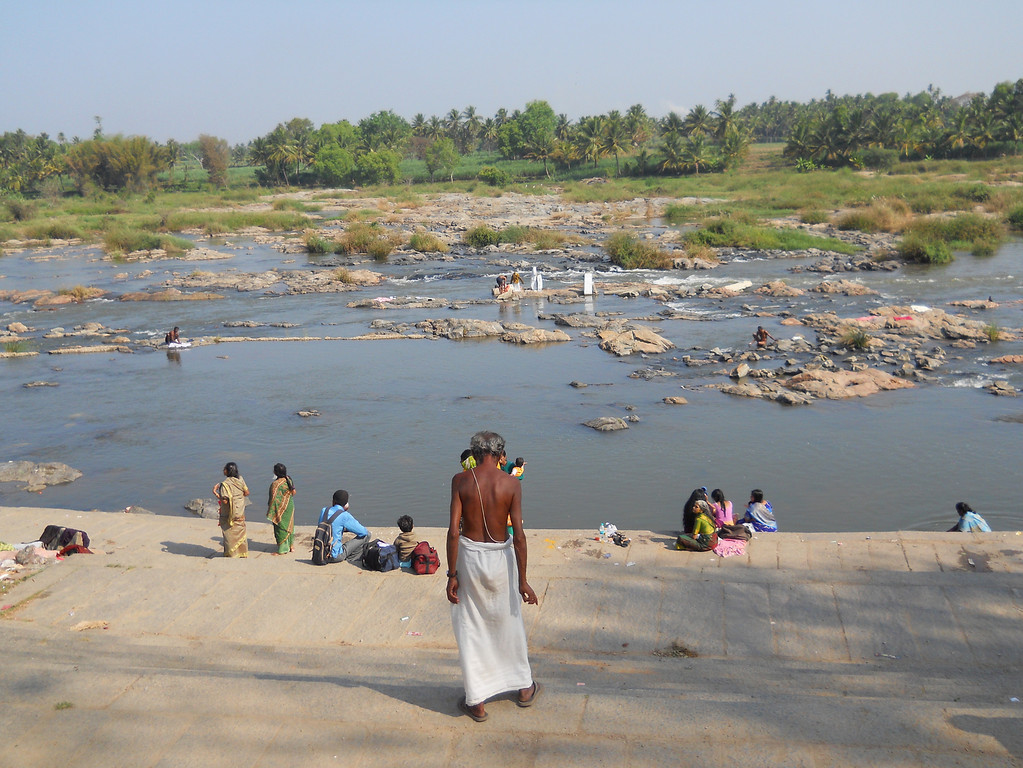 I took this last year on a bike trip in India.  This was our first day on the bikes and we came upon this river scene.  People were bathing, washing clothes, chatting.  It was incredible to see.