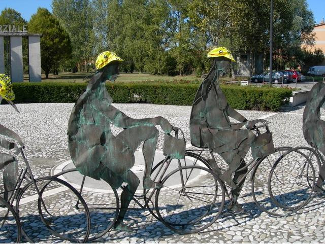 When the six of us on this tour saw this bicycle statue of sorts, we took the picture only after placing our Experience Plus hats on the riders' heads!