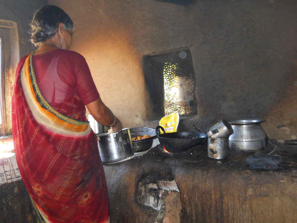 I took this picture on a bike trip in India 2011.  This woman is preparing our lunch at a roadside restaurant.