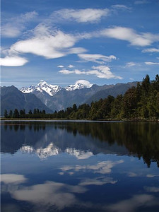 This was our rest day in Fox Glacier, so we rode our bikes to Lake Matheson. Crystal blue waters, wonderful temperature, and New Zealand clouds. Perfect!