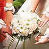 Bouquet of flowers and hands of bride and bridesmaids