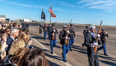The US Marines marching to Air Force One and receiving the 41st President