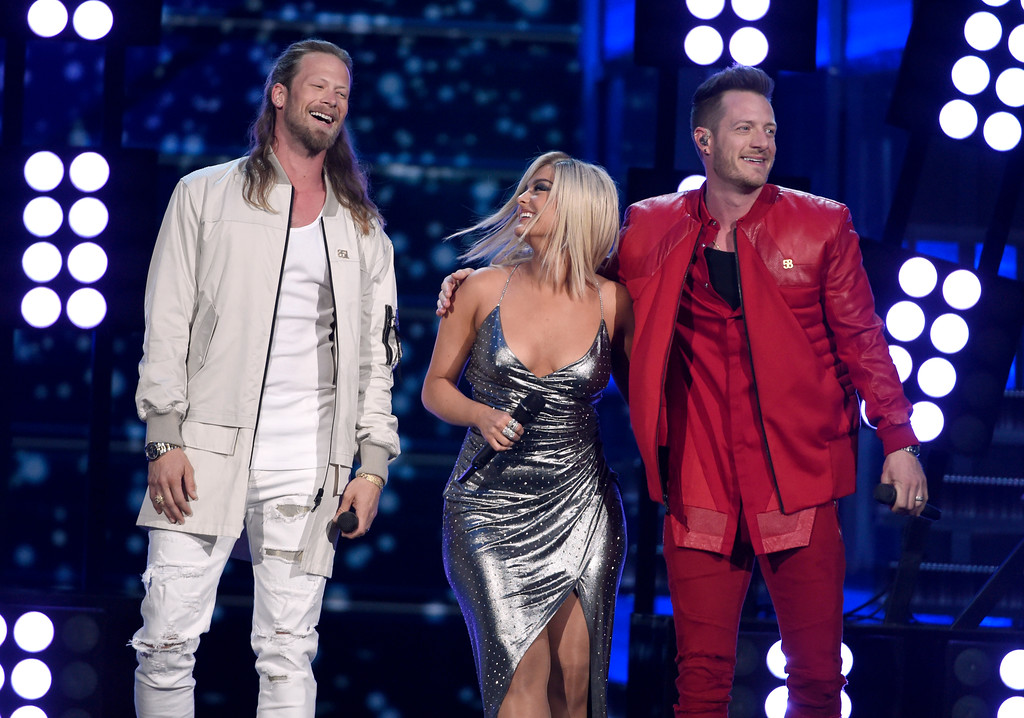 ". Tyler Hubbard, right, and Brian Kelley, left, of Florida Georgia Line, and Bebe Rexha, center, perform ""Meant to Be\"" at the 53rd annual Academy of Country Music Awards at the MGM Grand Garden Arena on Sunday, April 15, 2018, in Las Vegas. (Photo by Chris Pizzello/Invision/AP)"