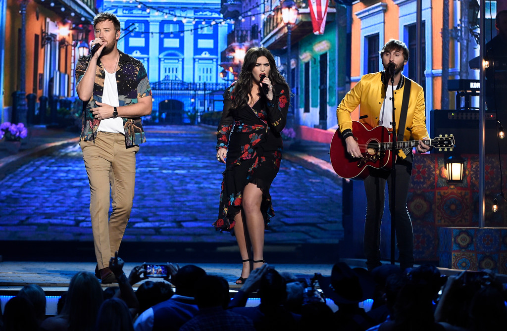 ". Charles Kelley, from left, Hillary Scott and Dave Haywood, of Lady Antebellum, perform ""Heart Break\"" at the 53rd annual Academy of Country Music Awards at the MGM Grand Garden Arena on Sunday, April 15, 2018, in Las Vegas. (Photo by Chris Pizzello/Invision/AP)"