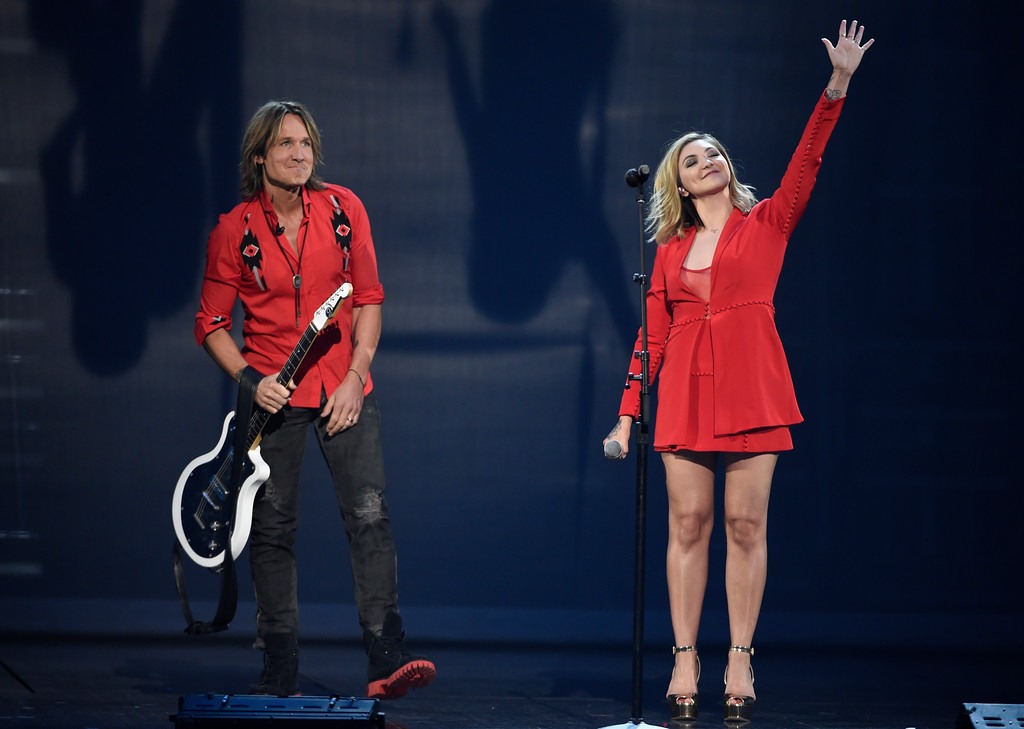 ". Keith Urban, left, and Julia Michaels perform ""Coming Home\"" at the 53rd annual Academy of Country Music Awards at the MGM Grand Garden Arena on Sunday, April 15, 2018, in Las Vegas. (Photo by Chris Pizzello/Invision/AP)"