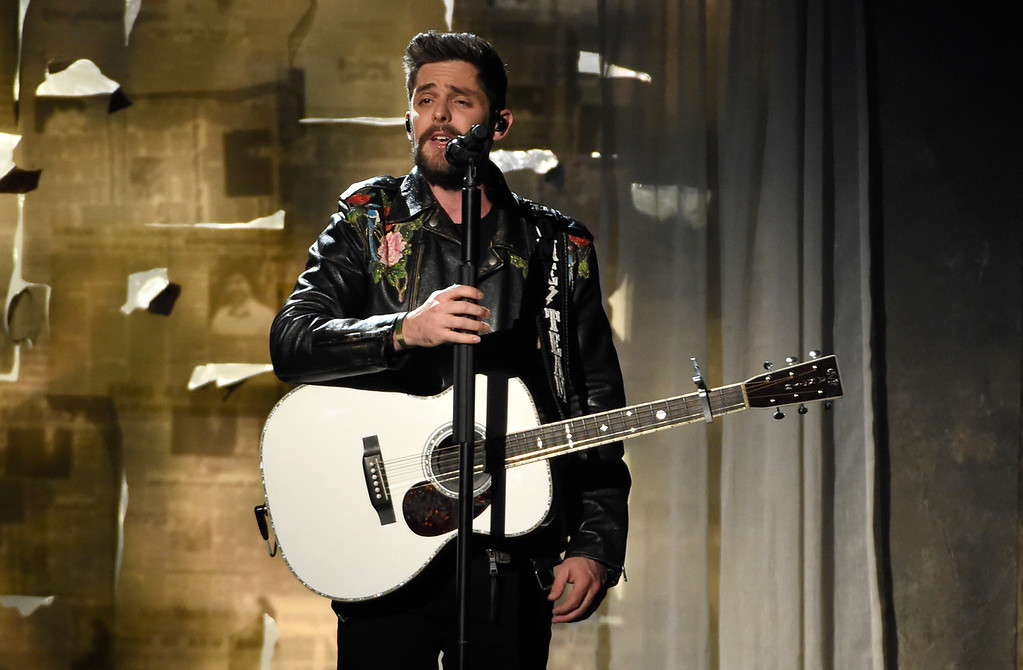 ". Thomas Rhett performs ""Marry Me\"" at the 53rd annual Academy of Country Music Awards at the MGM Grand Garden Arena on Sunday, April 15, 2018, in Las Vegas. (Photo by Chris Pizzello/Invision/AP)"
